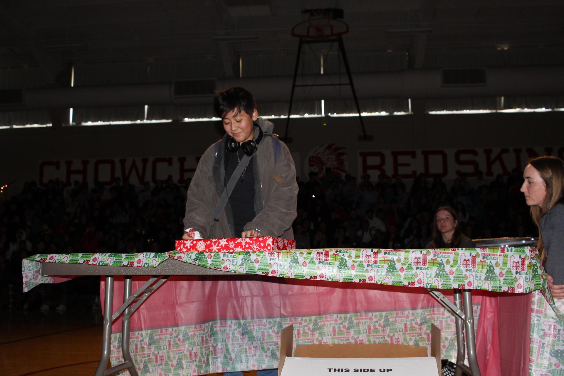 Nicolas Gonzales  opening his gift