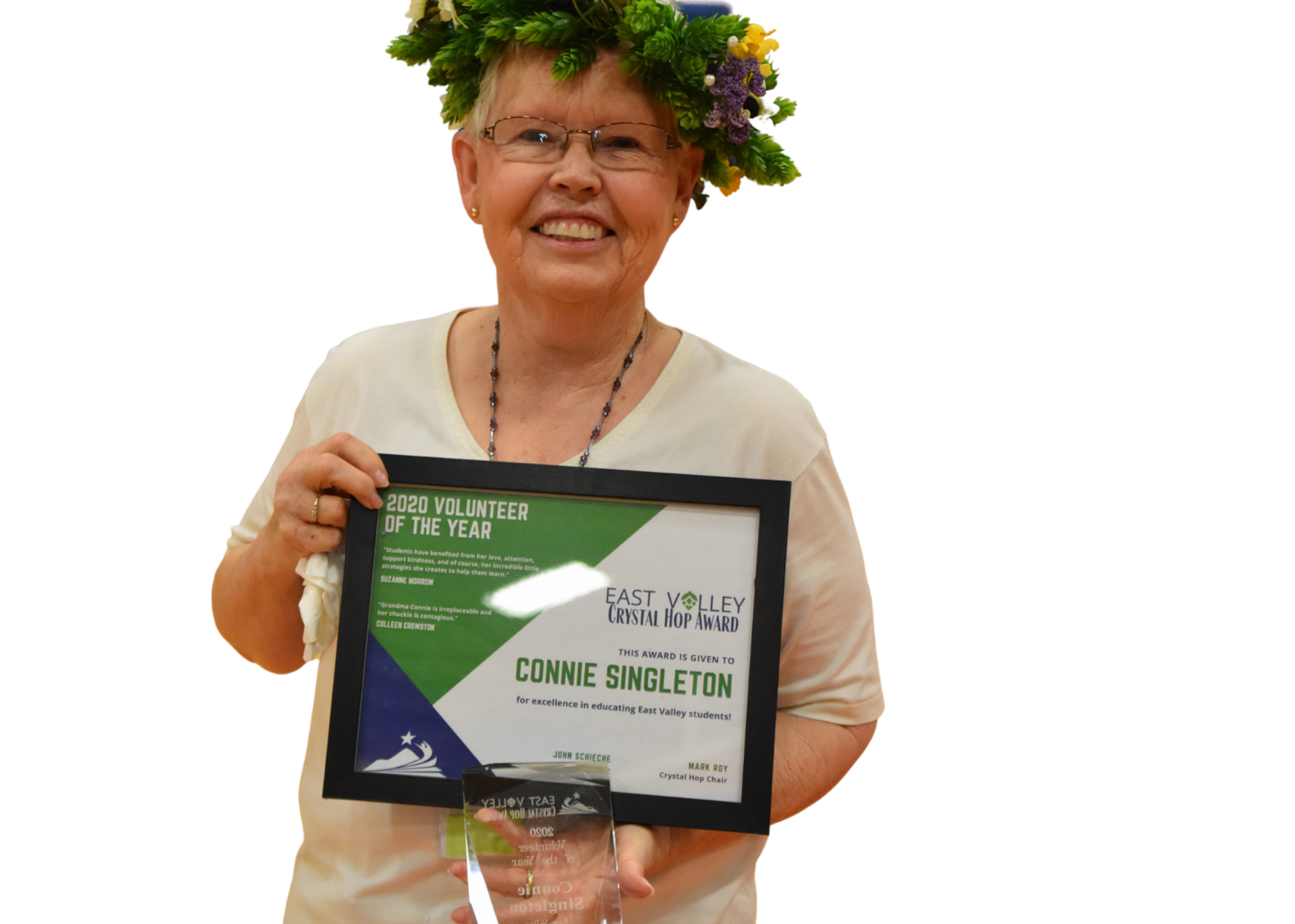 Connie Singleton wearing hop crown and holding hop plaque.