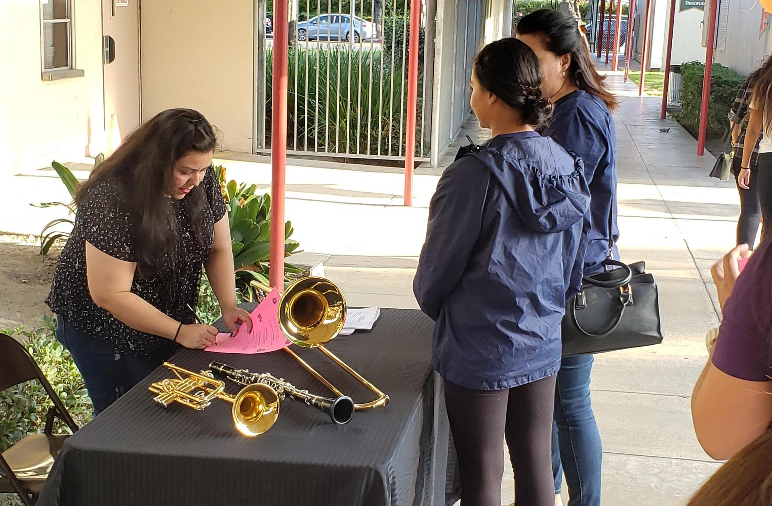 Students getting band instruments