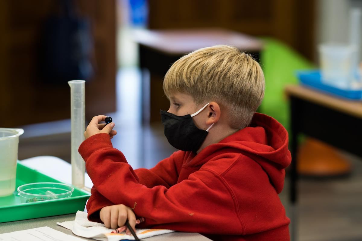 St. Timothy's School second grader working on a science experiment