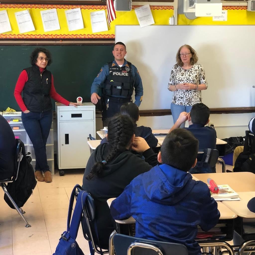 Mrs. Del Gaudio, Officer Vasquez, & Principal O'Connell talking to room 302 students