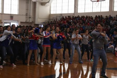 Students dancing with our Theater Arts teacher, Mr. Soto, during a pep rally.