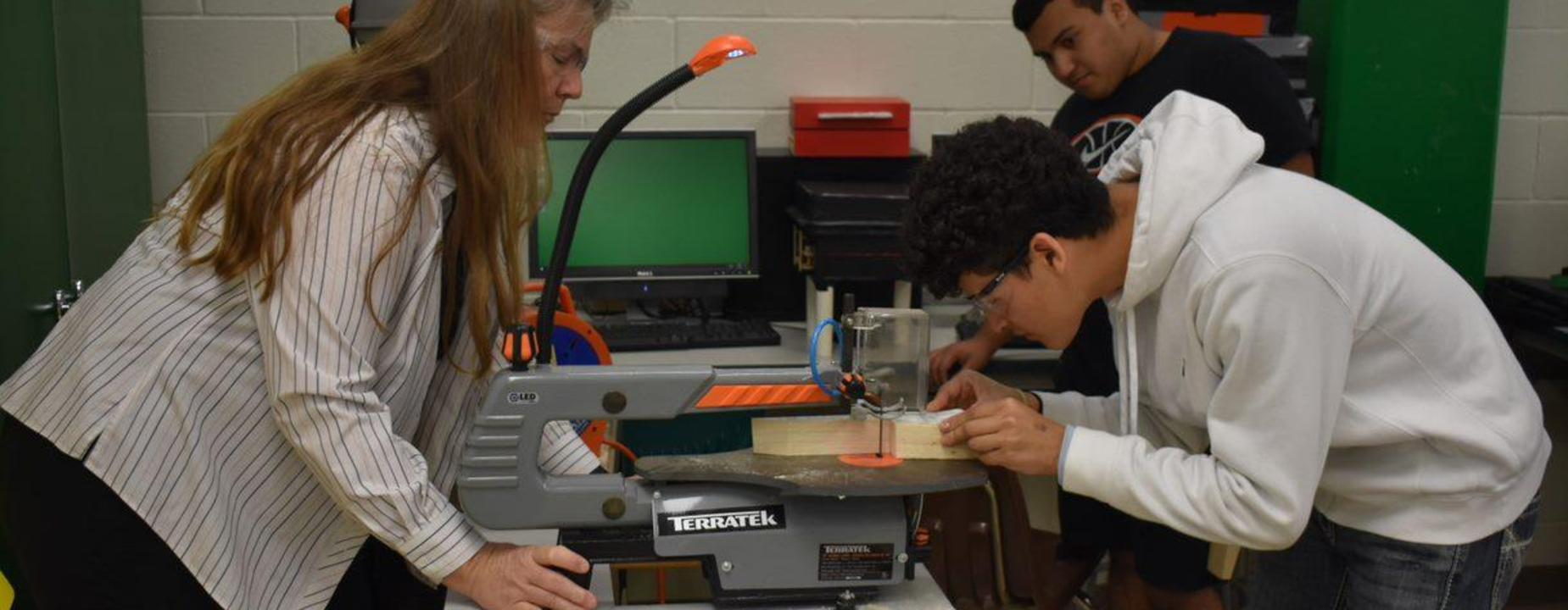 Student cutting wood
