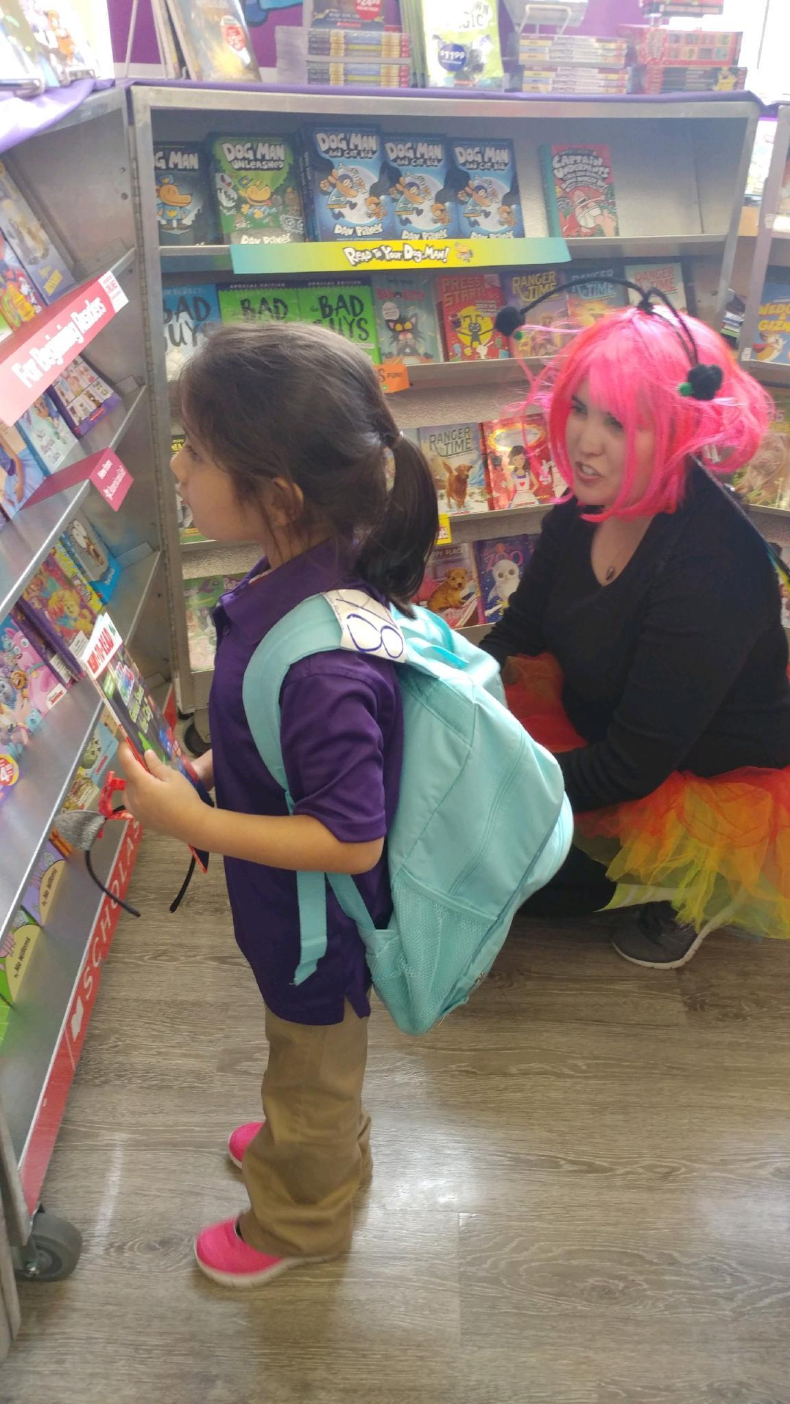 Kinder student, Sophia Marie Rodriguez from Ms. Guzman's class, stopped by the book fair after school to pick an enchanting read.