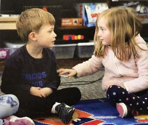 partners in play students talking