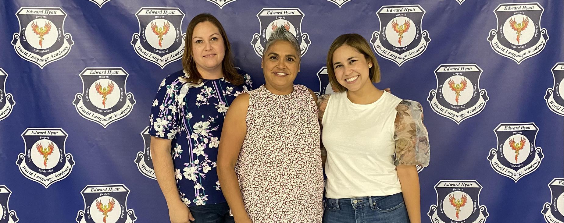3 ladies standing