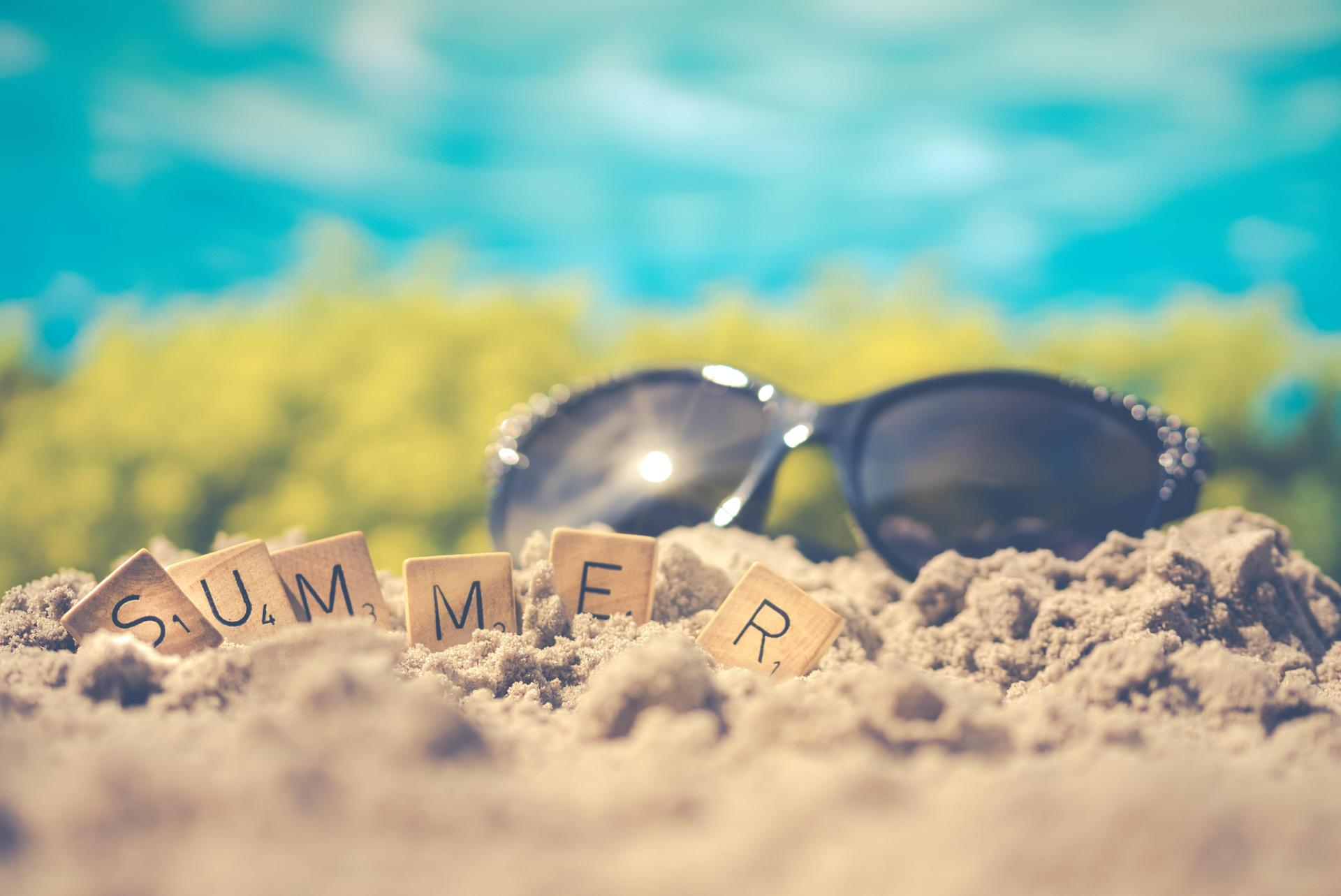 Photo of sunglasses and blocks spelling summer