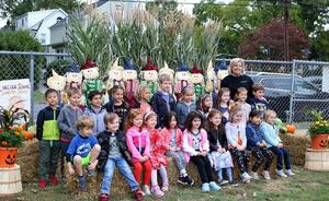 Photo of kindergarten class posing for a picture at annual Pumpkin Patch.