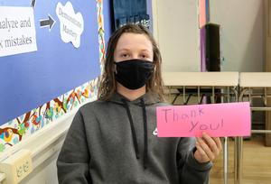 As part of Random Acts of Kindness Week, Roosevelt students made cards for members of the Westfield community, including senior citizens, first responders, and teachers past and present.  Pictured here:  student holding up card with