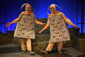 two guys dressed as cheese graters