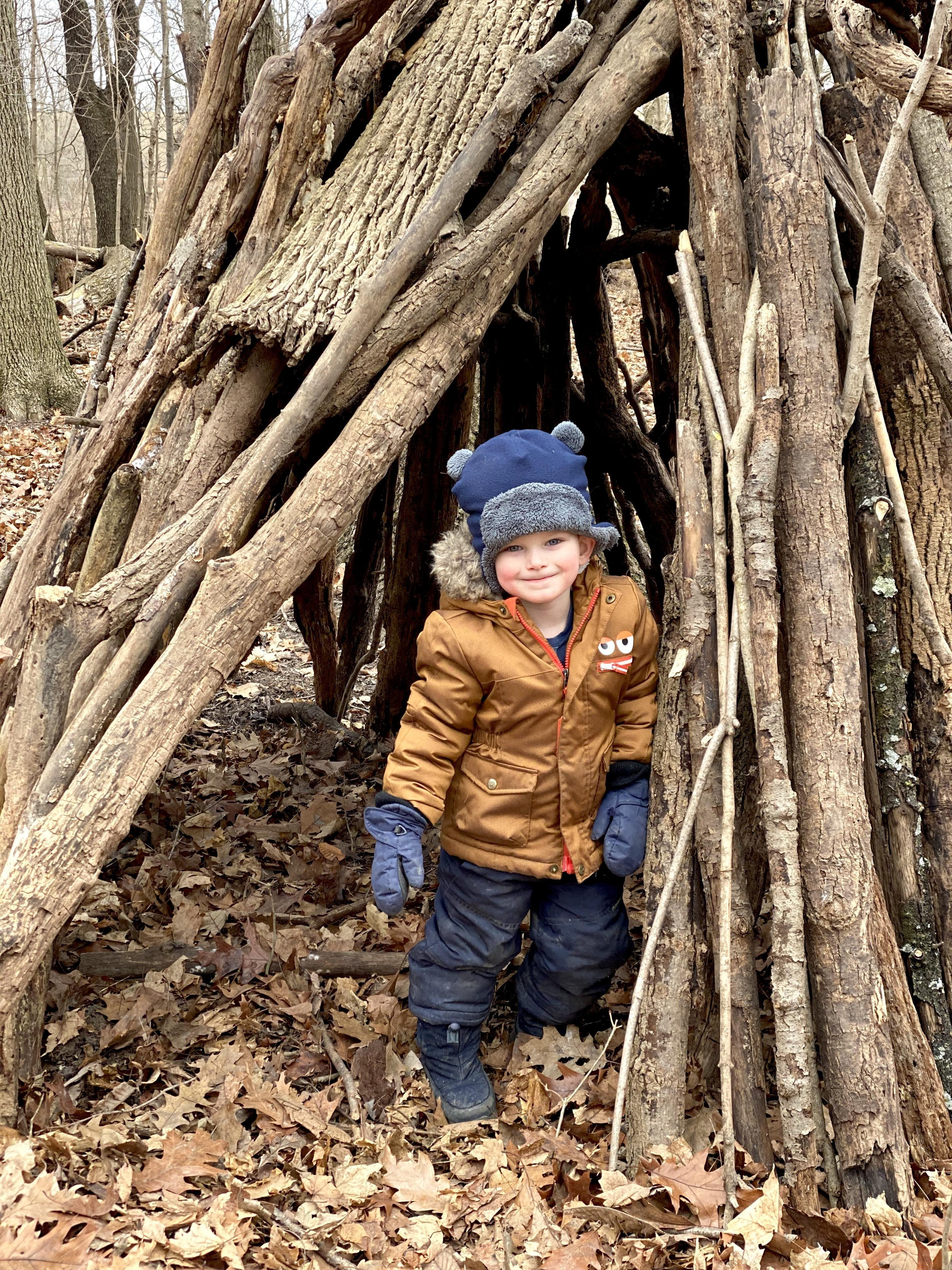 child in tree fort