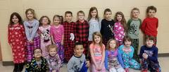 Students posing wear pajamas to school