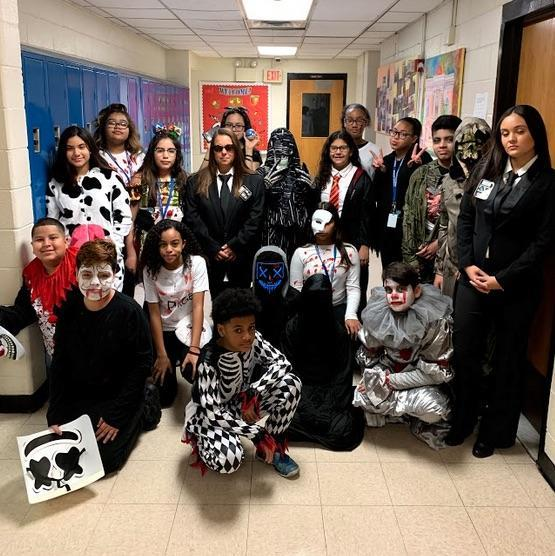 ms. Rossi's class wearing costumes in the hallway