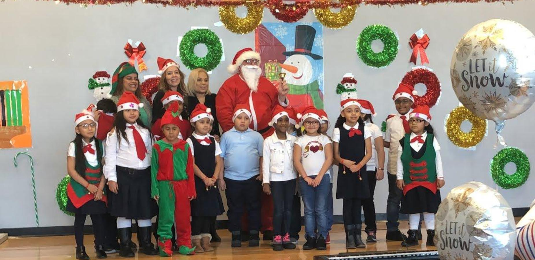 Student of the Month Celebrants on stage with Santa Claus - December 2018