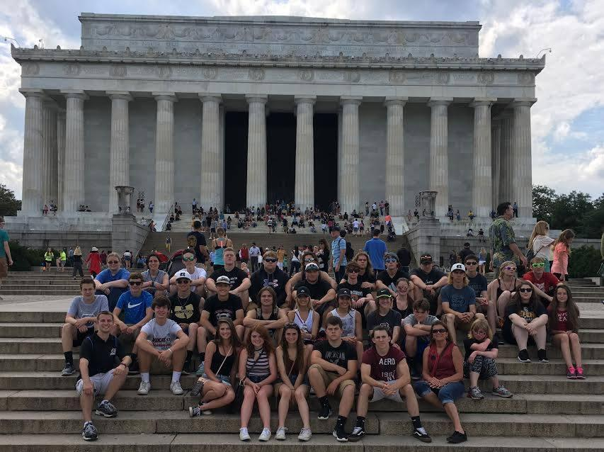 Group photo of the senior trip to the Nations Capital in front of the Lincoln Memorial.