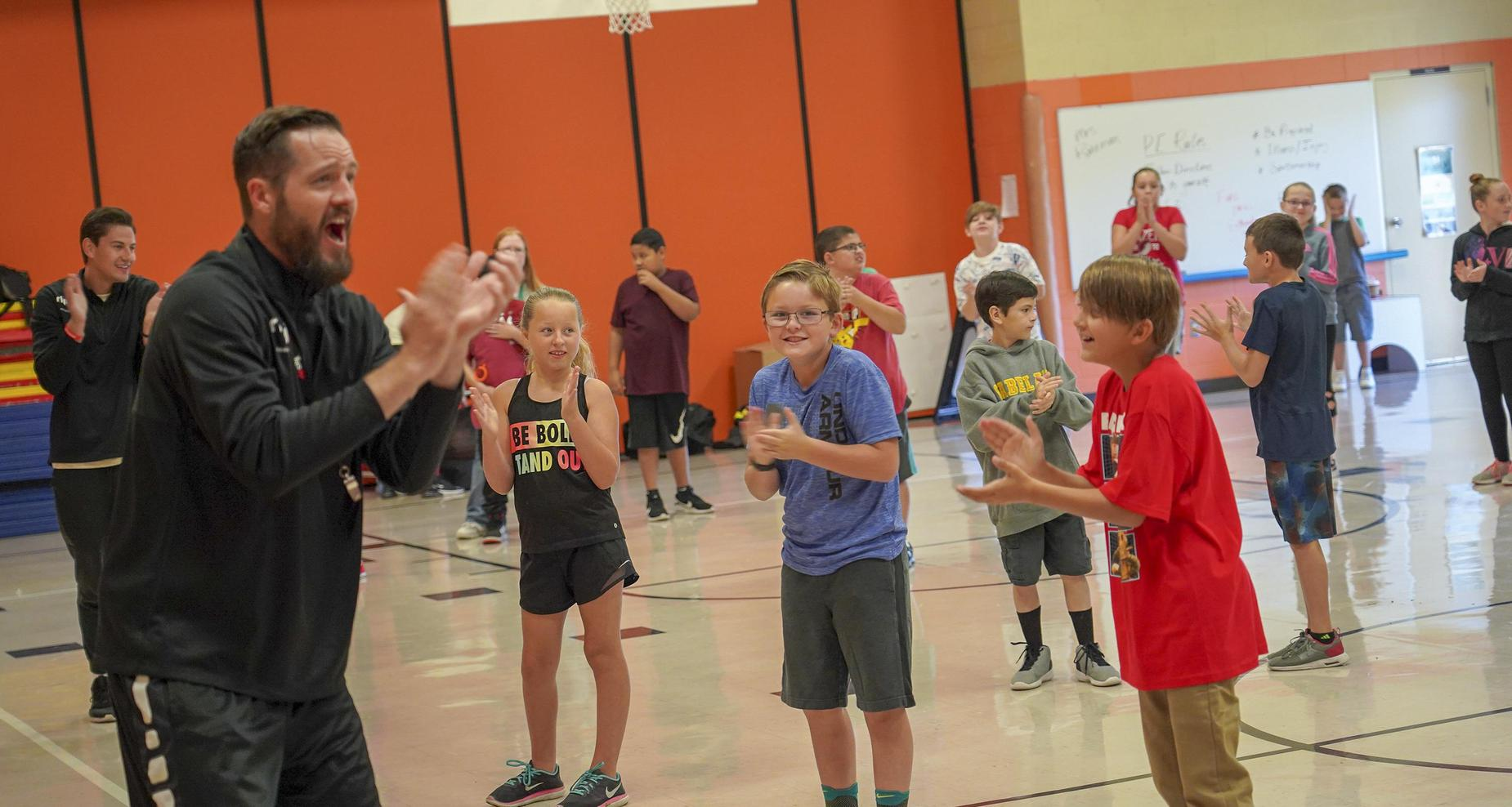 Students clapping while in PE class.