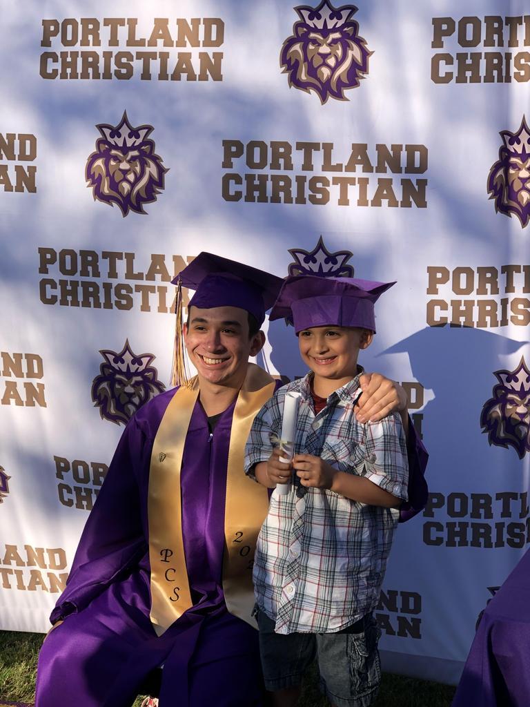 Kindergarten graduate and graduating senior