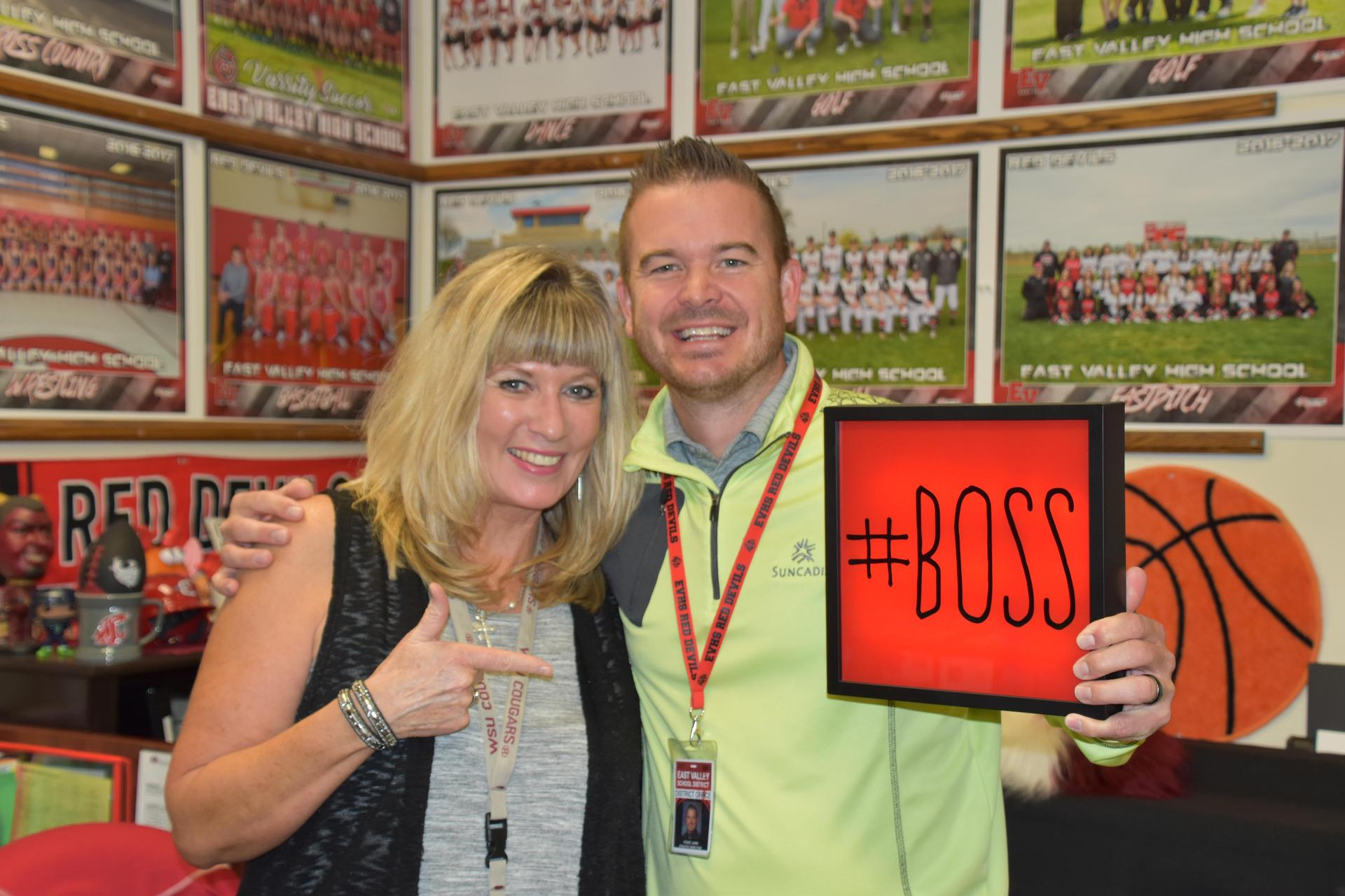John Yount and Lisa Rossow with the #Boss Award for their work to keep families engaged on Athletics Twitter Account.