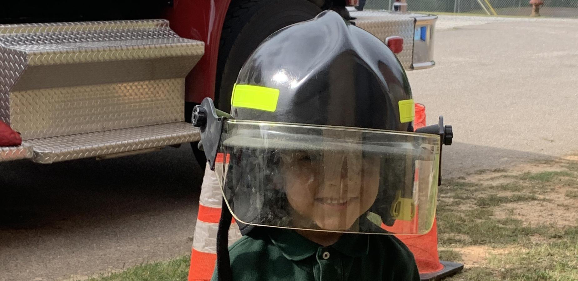 CD student in firefighter helmet