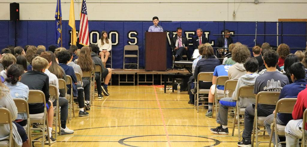 Photo of Roosevelt student speaking at Veterans Day assembly.