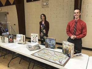 photo of teachers behind table at activity fair