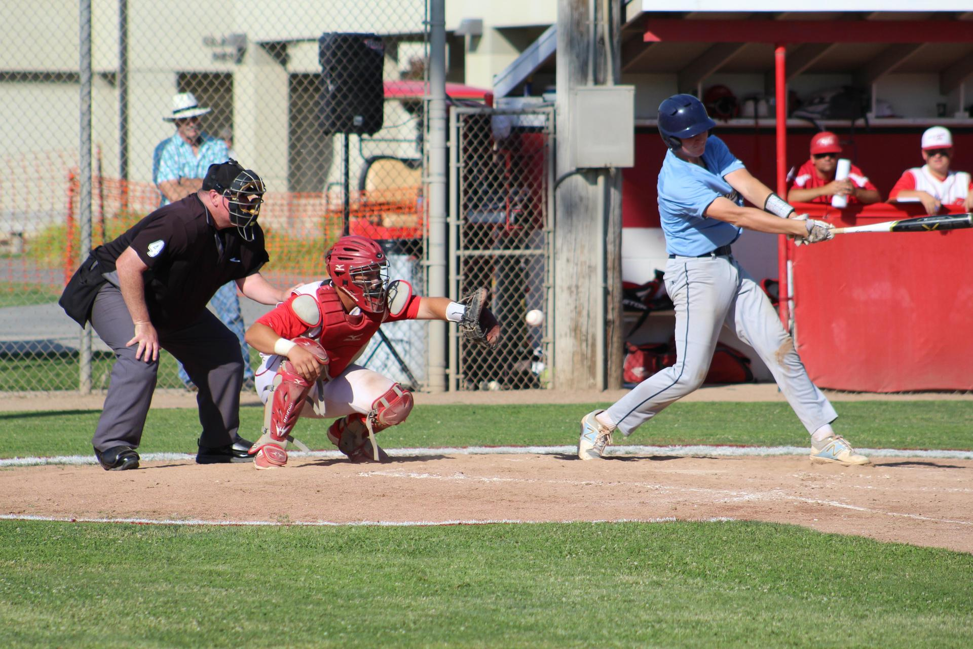 Baseball players in action against Central Valley Christian