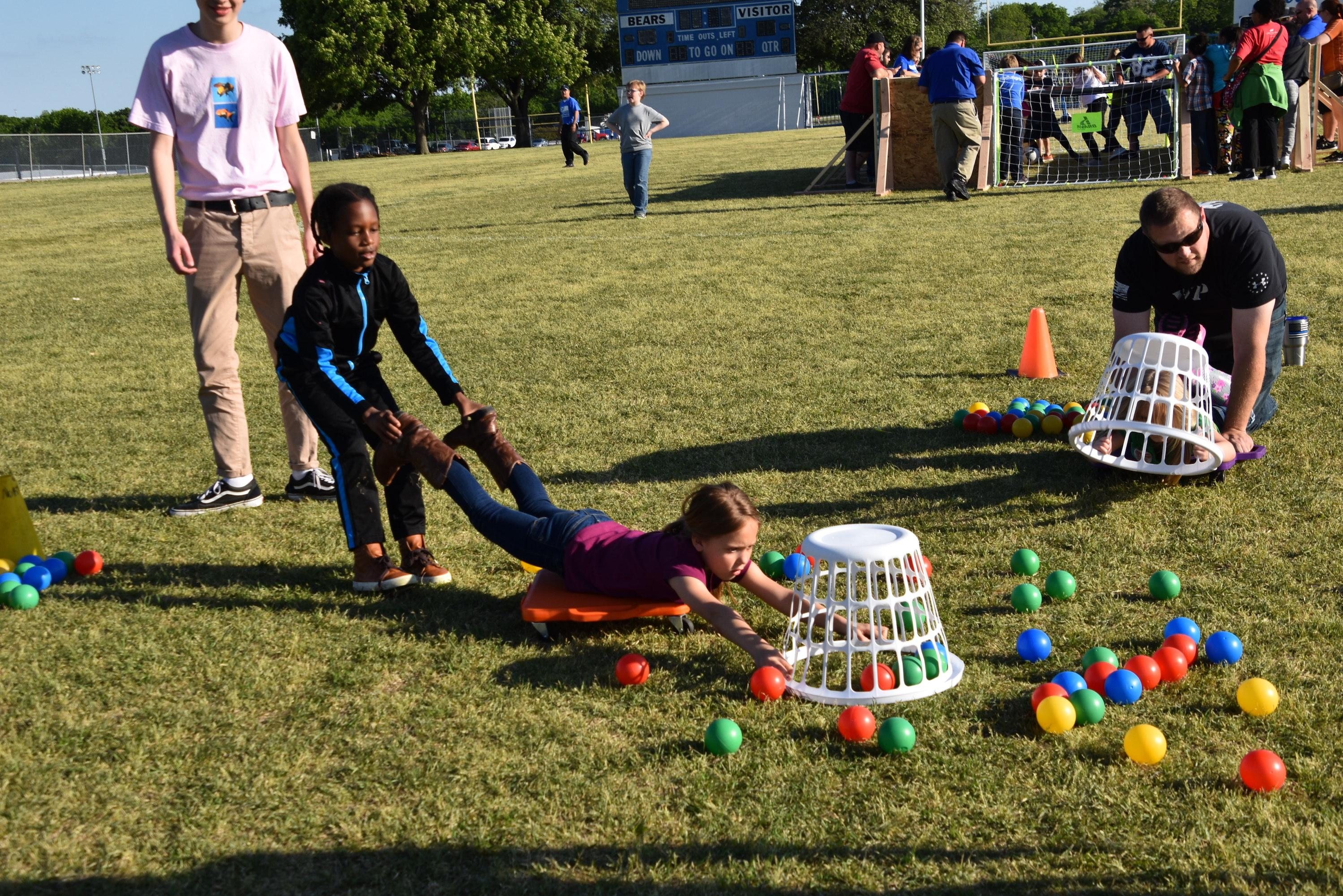 Families play Human Hungry Hippo at the district's Family Game Challenge on April 24.