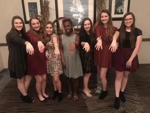 A group of girls show off their OLSH class rings