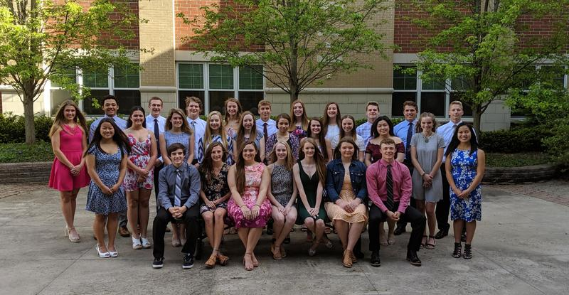 Students graduating with distinction formal picture.