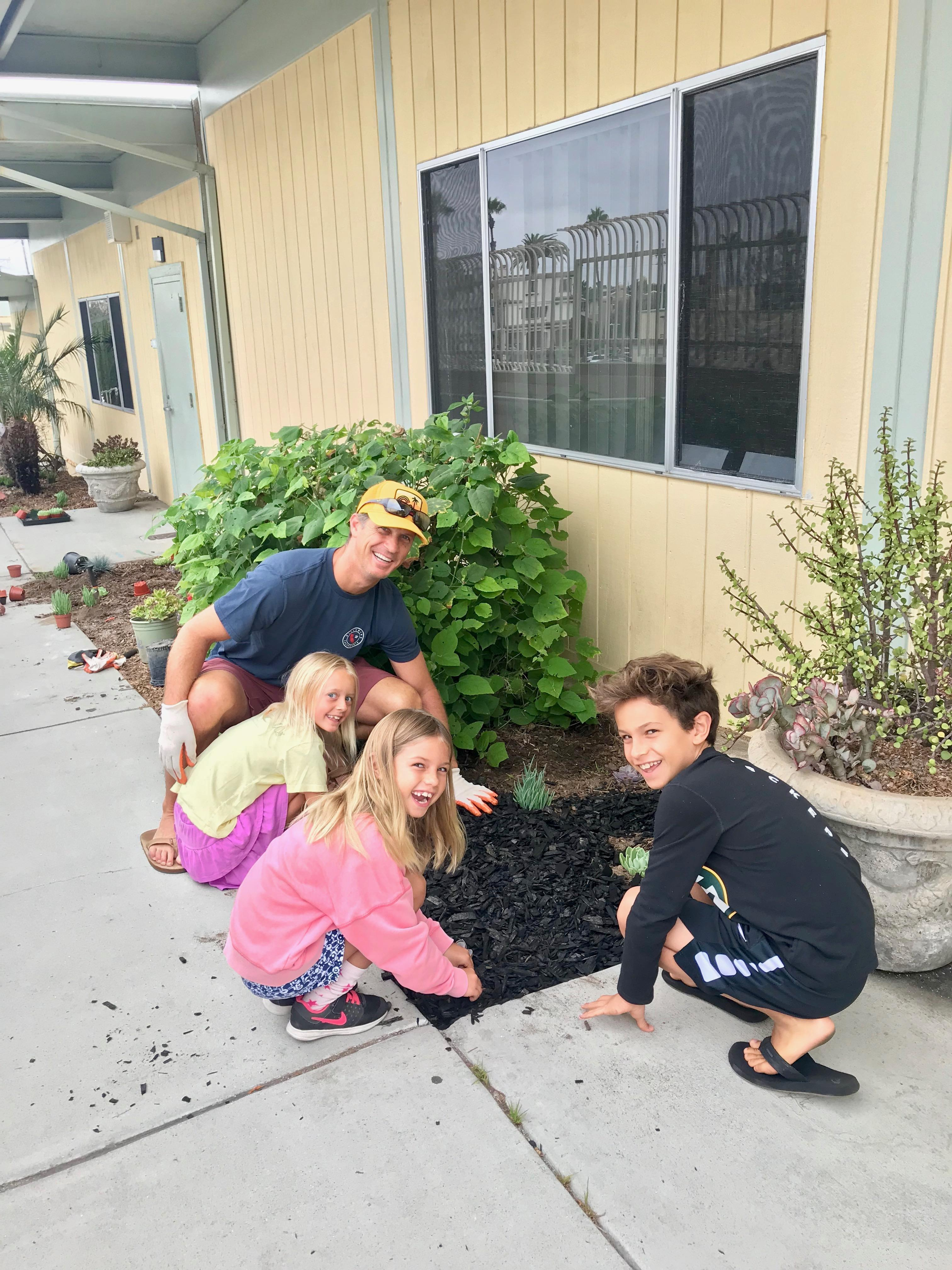 kids planting flowers at beautification day