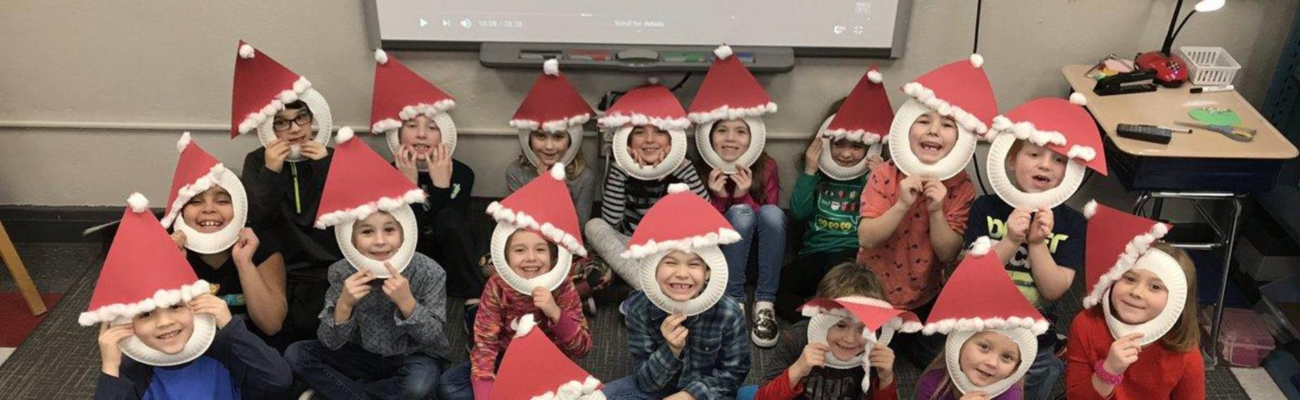 First grade students getting ready for Christmas