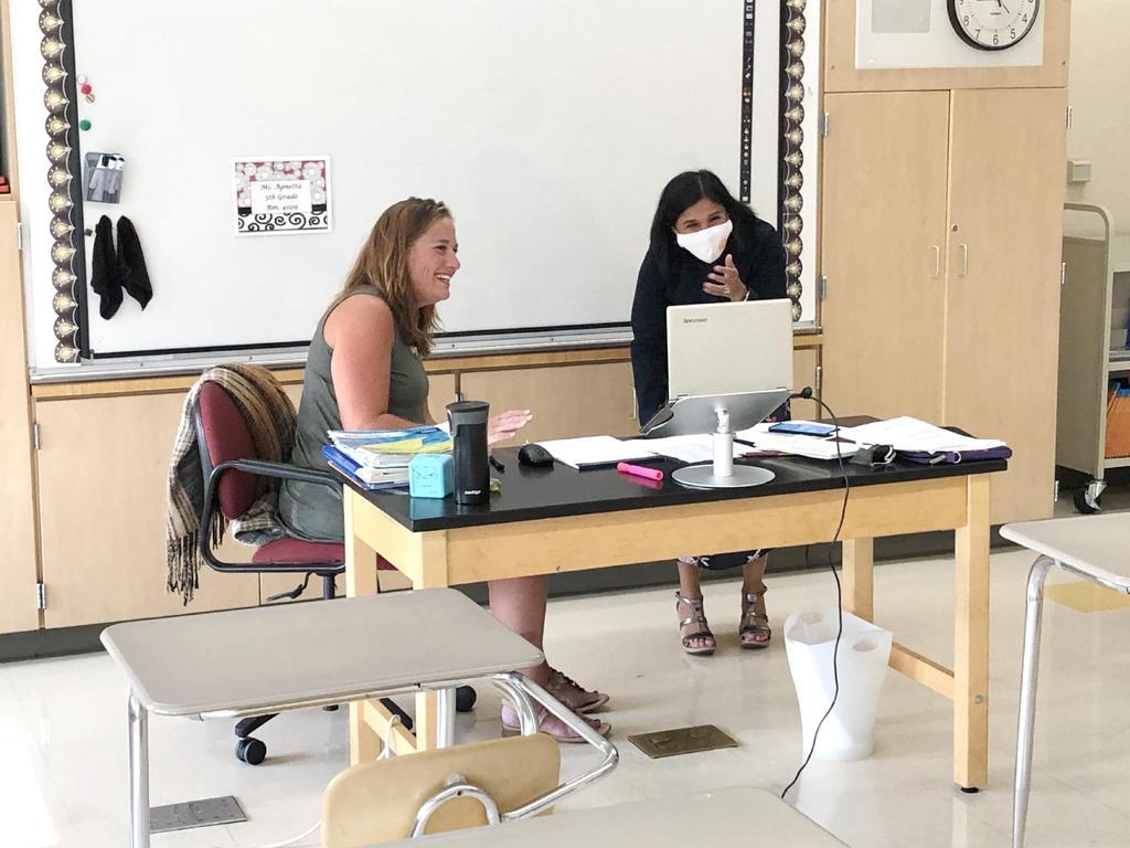 Teacher and superintendent at a desk
