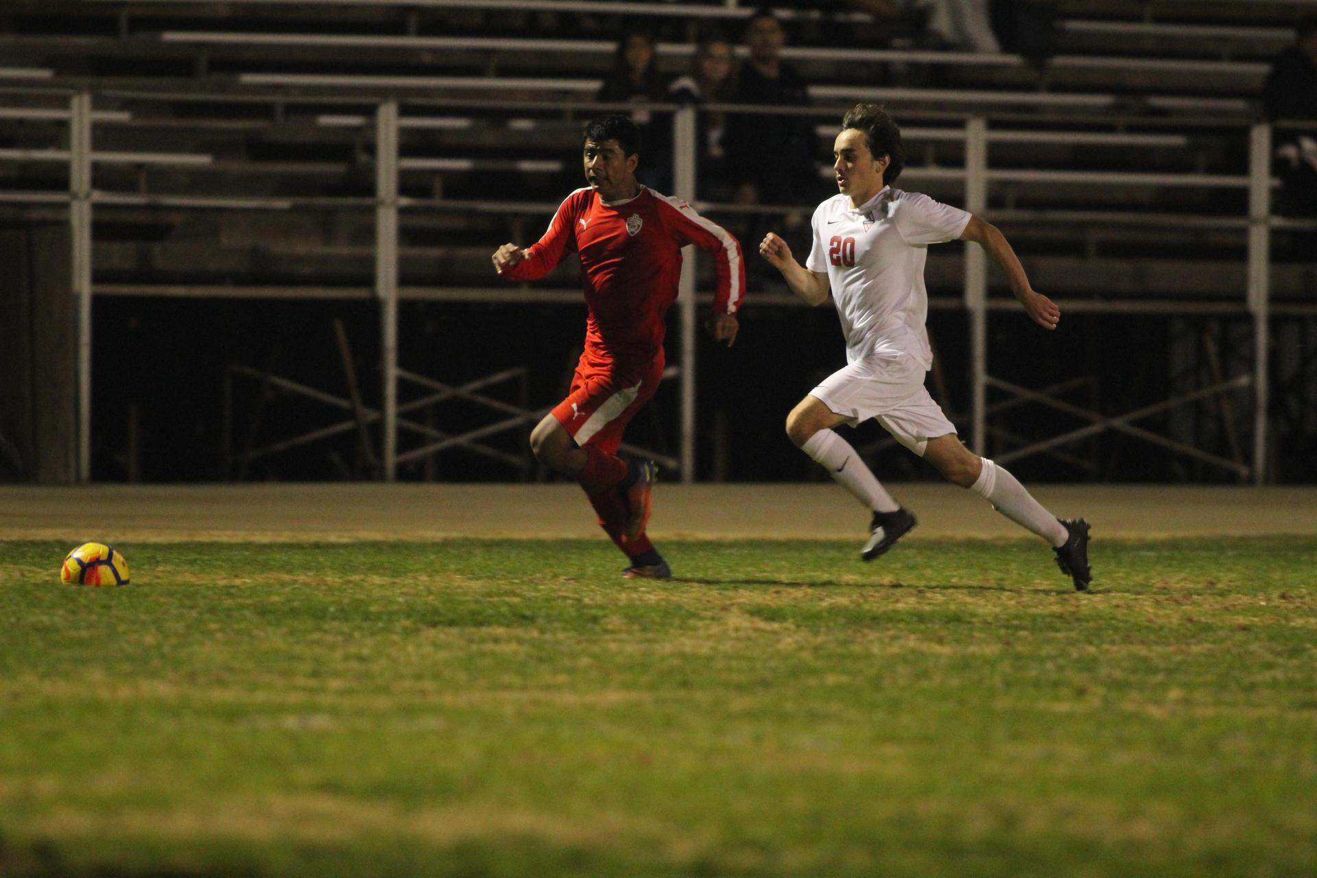 Cristobal Galvan running to the ball