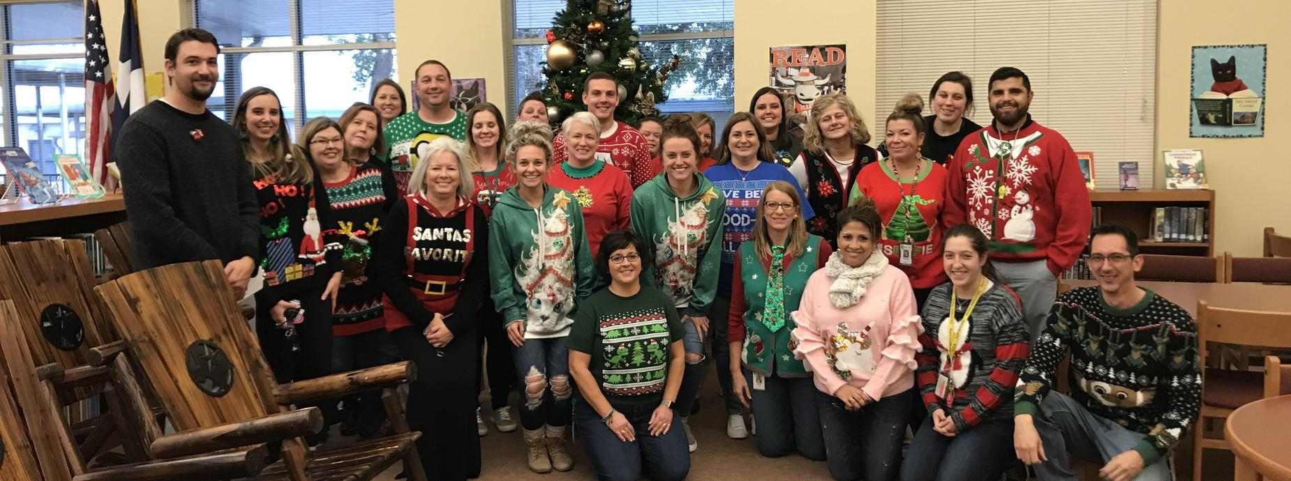 Teachers wearing Christmas sweaters