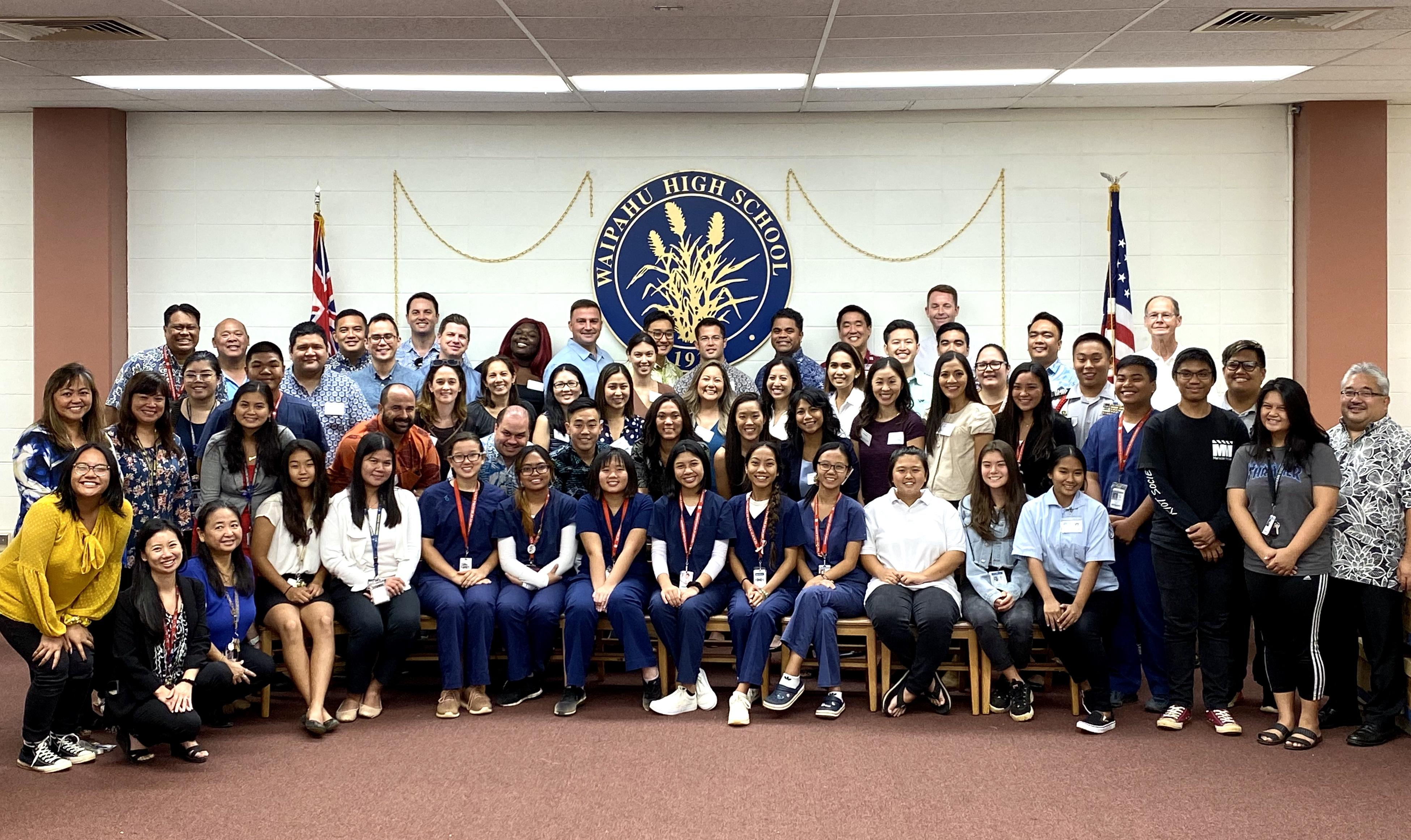 Pacific Century Fellows photographed with students and staff of Waipahu High School