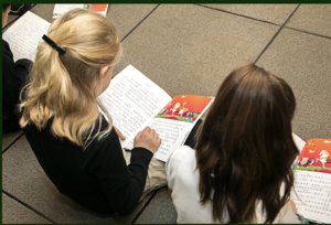 Students reading at bilingual education school