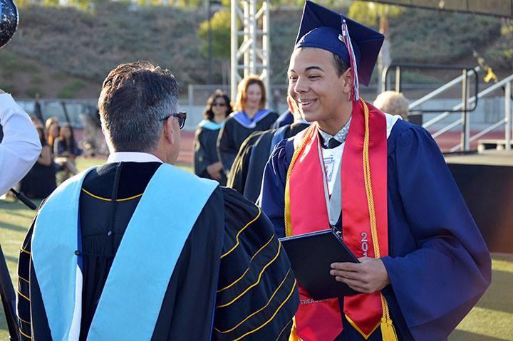 Dr Domene congratulating a student