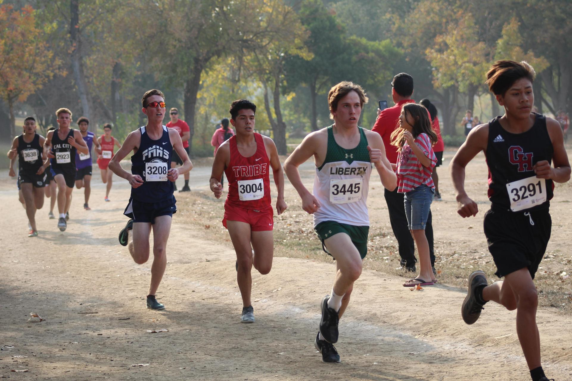 Boys running in the Central Section D-5 Cross Country Championship race.