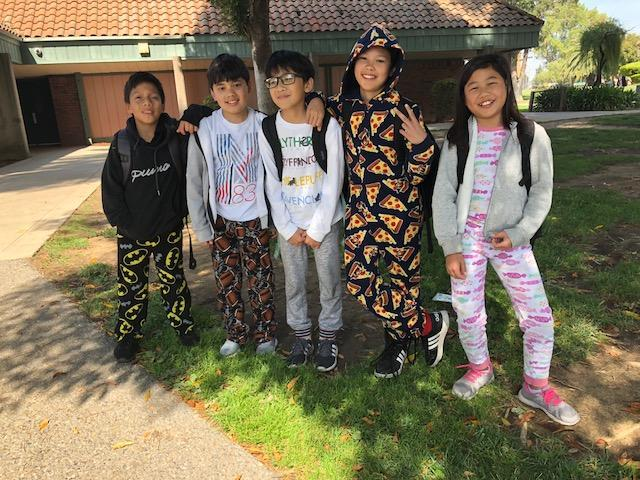 Five CCA students relaxing in their PJ's for Spirit Week.