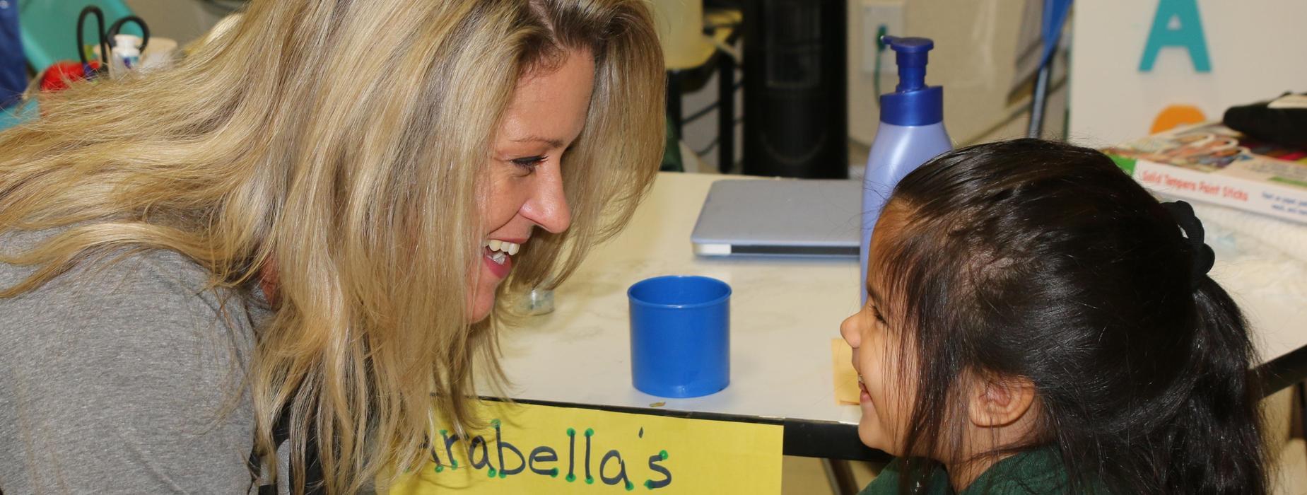 Principal and student smiling.