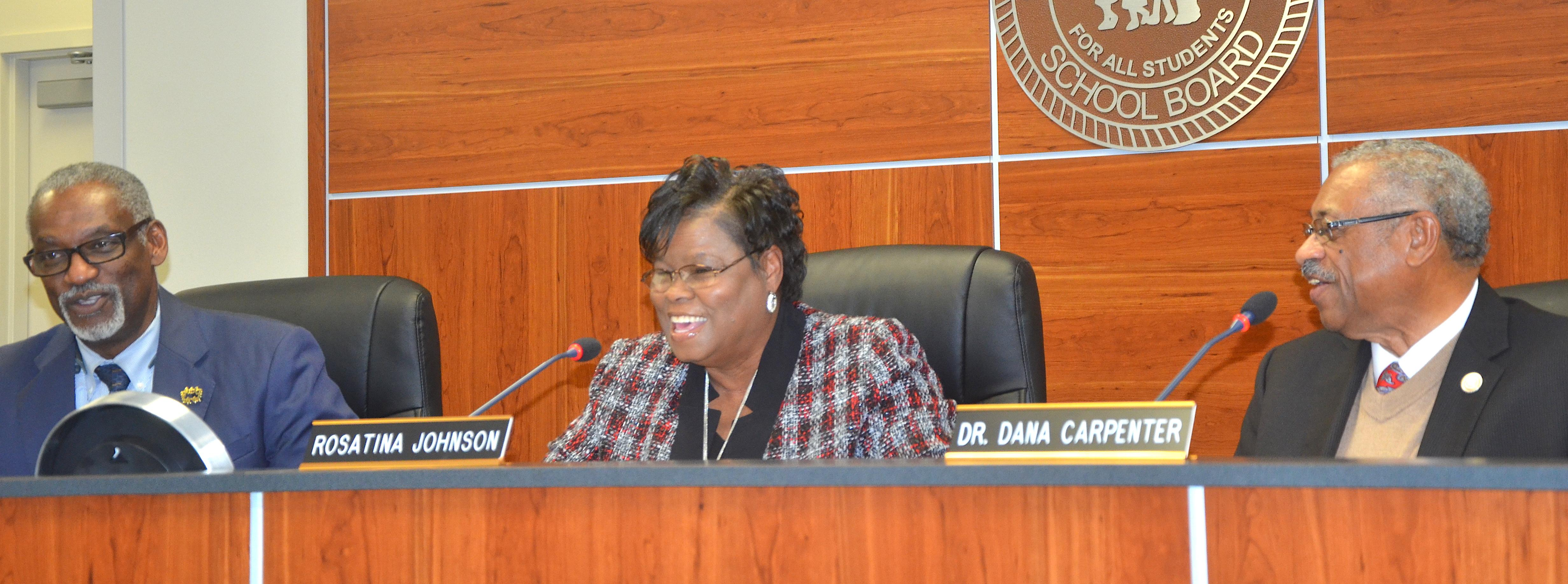 Photo of outgoing Baker school board President Rosatina  Johnson sharing a laugh with incoming Board President Dr. Dana Carpenter