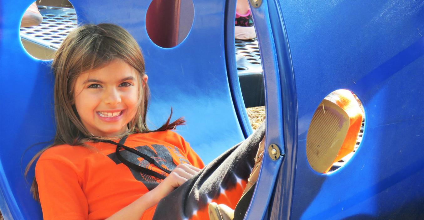 A Lee Elementary student plays on the play structure.