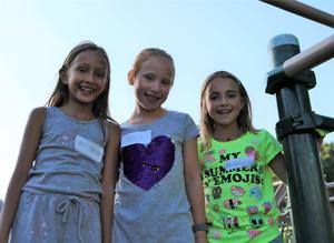 Three Jefferson School students smile for the camera during Summer Social.
