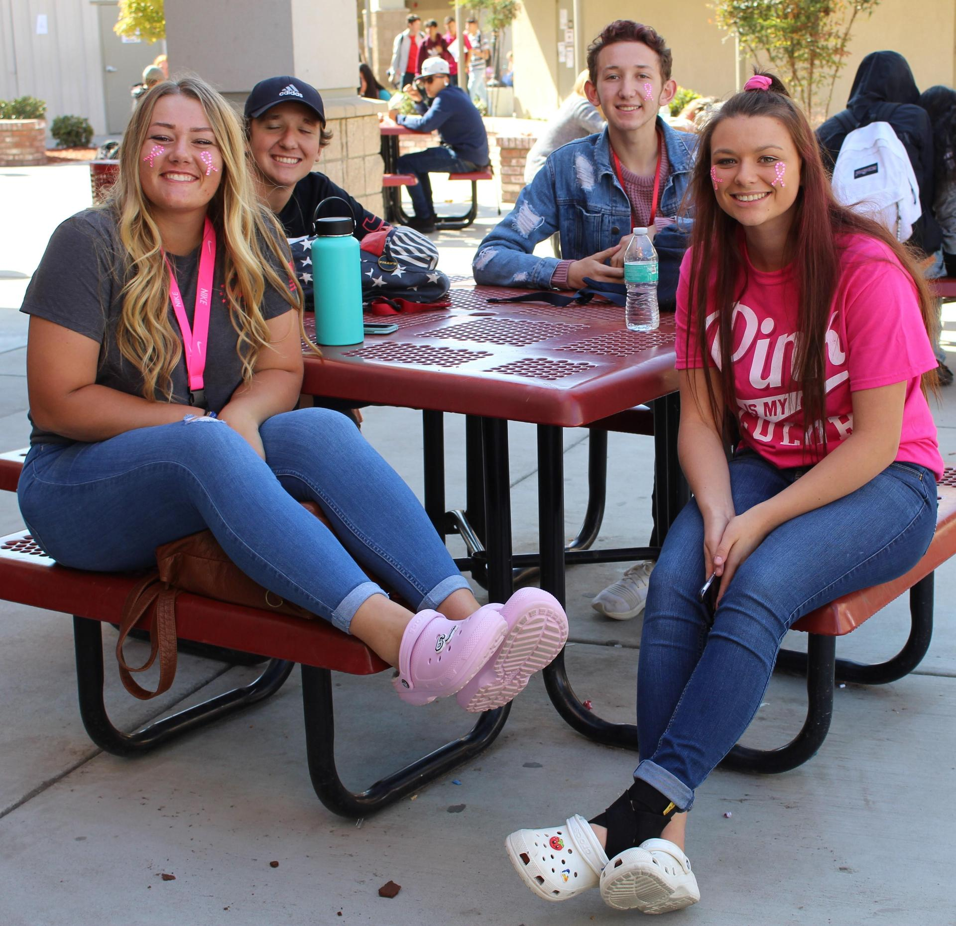 Students and staff wearing pink clothing to support awareness of Breast Cancer.