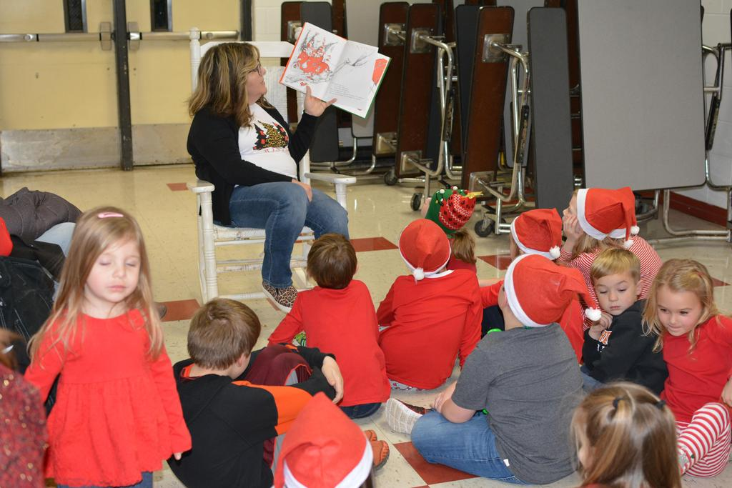 """Mrs. Smith reading """"How the Grinch Stole Christmas"""" by Dr. Seuss"""