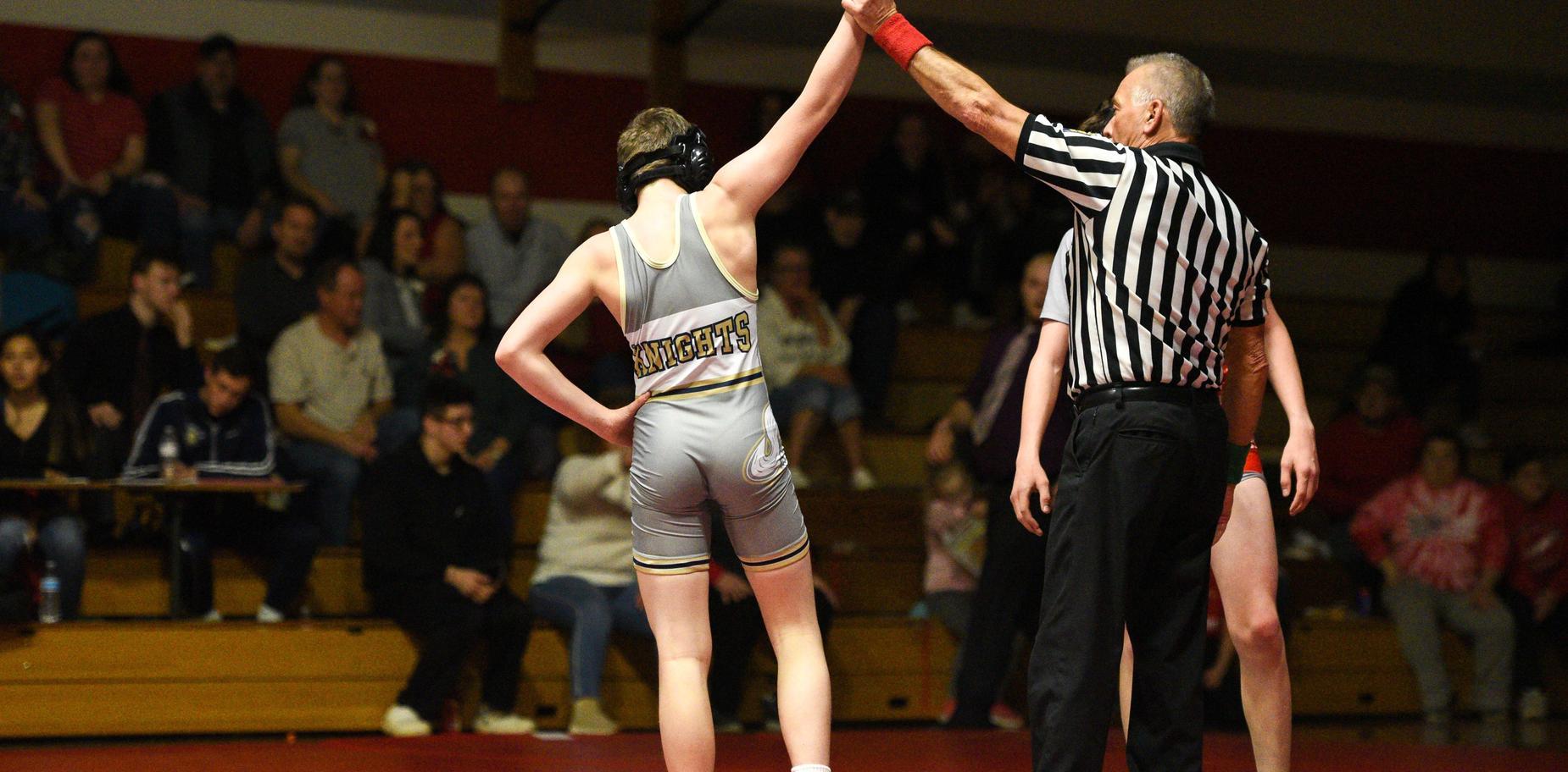 Knoch wrestler in win pose