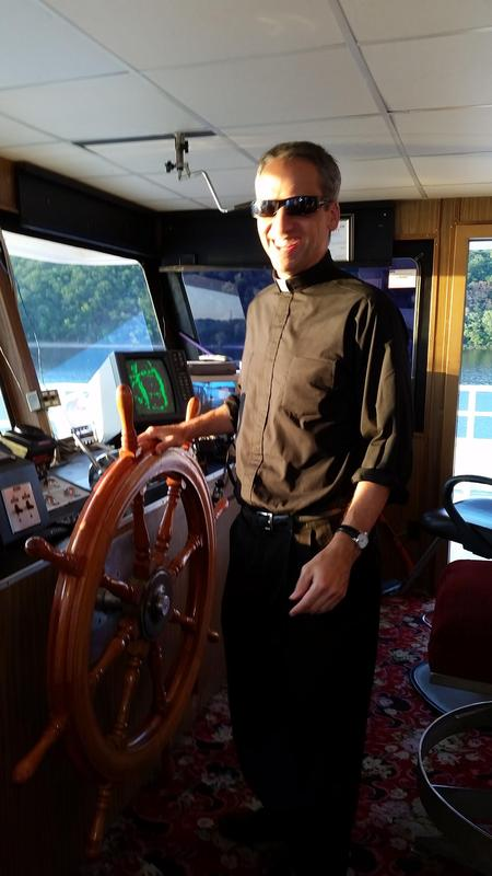 Triparish boat trip 2015 Fr Izen.jpg
