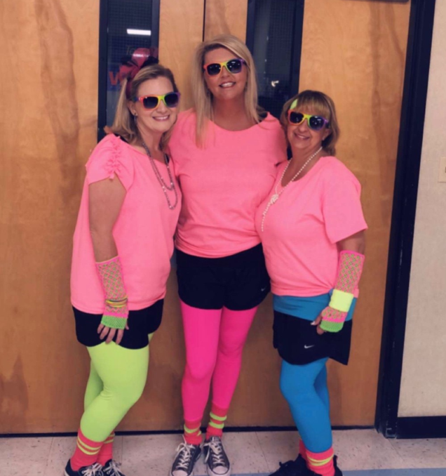 5th Grade Teachers dressed in 80's outfits.