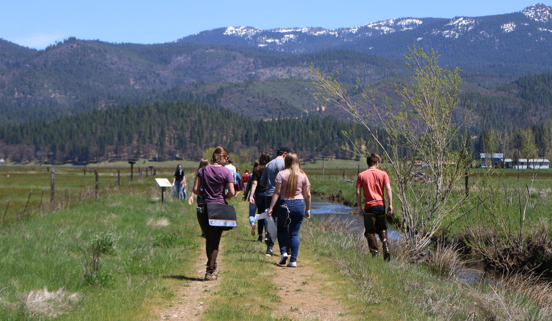 Students walking in the valley