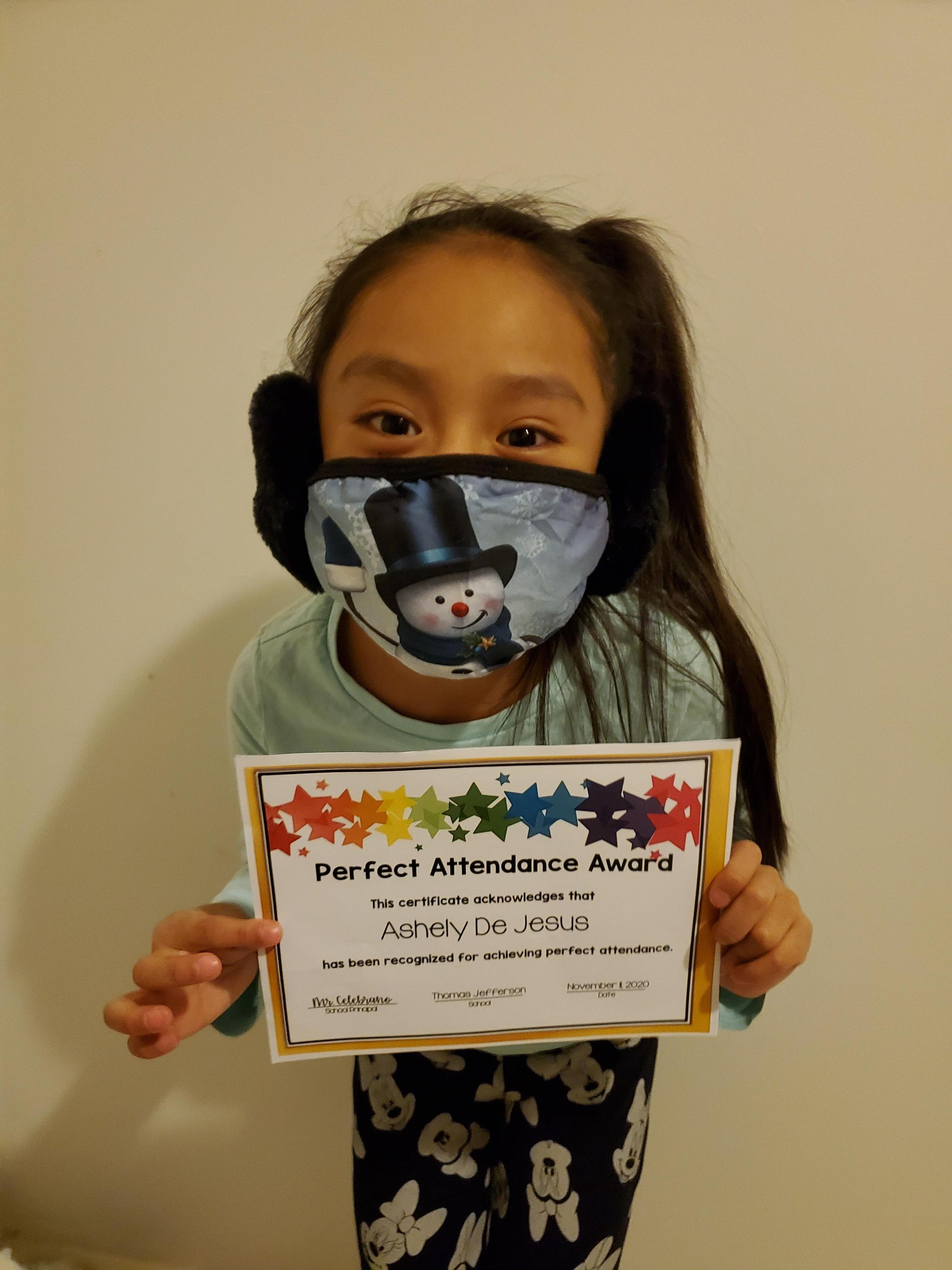 Ashely De Jesus holding perfect attendance certificate